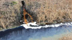 Colorful Chemical Liquid industrial Factory toxic waste in river Stock Footage