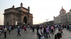 Indian citizens and tourists in front of Gateway to India in Mumbai. Stock Footage