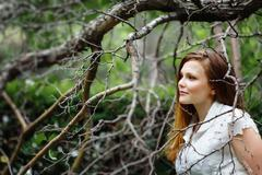 Amazing Portrait of Beautiful Woman in Forest Stock Photos