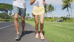 Low Section Of Couple Jogging In Park Stock Footage