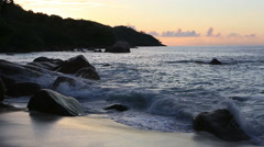 Waves at sunset on the beach of Anse Lazio Stock Footage
