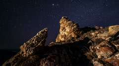 Time lapse rotating stars above mountain - stock footage