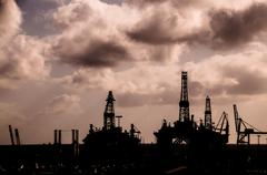 Oil Drilling Rig Silhouette Stock Photos