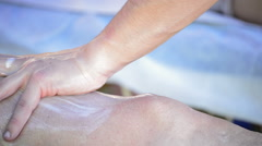 Physiotherapist massaging leg of an athlete Stock Footage