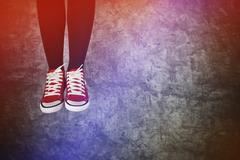 Careless Young Teenage Woman Jumping for Joy Stock Photos