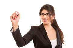 Business woman, drawing on whiteboard, isolated over white - stock photo