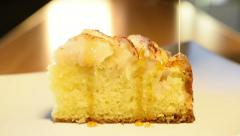 Dousing Slice of Apple Cake with Syrup - stock footage