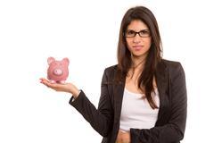 Young woman holding a piggy bank (money box) - savings concept Stock Photos