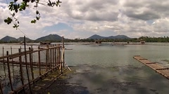 Bamboo Raft beside bamboo fish pen tracking shot Stock Footage