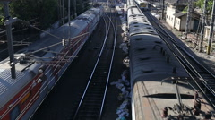 Aerial view on two trains passing the railway in Mumbai. Stock Footage