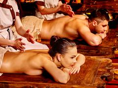 Couple having Ayurvedic spa treatment Stock Photos