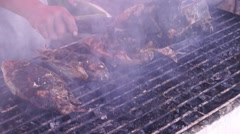 Roasting Whole Tilapia Fish on charcoal Stock Footage