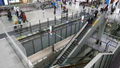 Airport escalator travelling down. View from upper floor Stock Footage