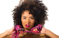 Exotic beautiful young girl with dark curly hair holding whip posing Stock Photos