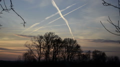 Stock Video Footage of Contrail Cross on Sky