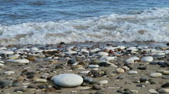 Pebbles on beach - stock footage