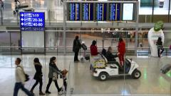 Airport passage, timetable aside, passengers walking Stock Footage