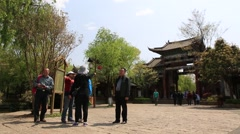 Tourists at the gate of Shuhe old town in Lijiang Stock Footage