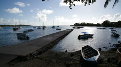 Boats at fishing village late afternoon Stock Footage