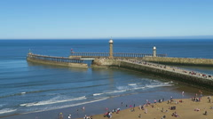View of tourists on Whitby beach Stock Footage
