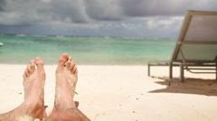 Sandy feet at beach enjoy the sun Stock Footage