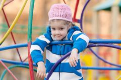 Four-year girl provocatively wondered at the playground - stock photo
