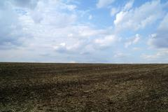 Freshly Plowed Field in Spring Ready for Cultivation Stock Photos