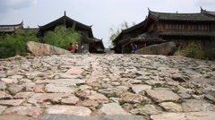 Tourists walking on the stone road bridge at Shuhe old town  Stock Footage