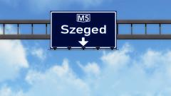 4K Passing Szeged Hungary Highway Road Sign with Matte 2 stylized Stock Footage