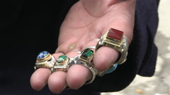 Kabul downtown the old city Afghanistan jewelry seller with rings Stock Footage