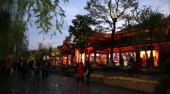 Tourists walking on the stone street in Lijiang old town at night Stock Footage