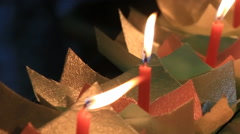 Burning candles for hope  on the street in Lijiang Stock Footage