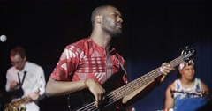 african musician dancing with bass.mp4 - stock footage