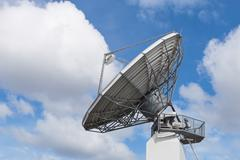 Big radar parabolic radio antenna global information data streaming broadcast Stock Photos