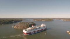 Passengership Amorella passes through a narrow fairway - stock footage