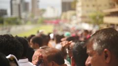 Crowd at The Mauritius Turf Club during sunny day Stock Footage