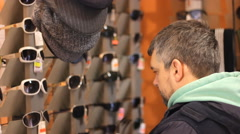 Man Browsing in Sunglasses Shop Stock Footage