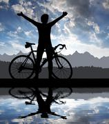 Silhouette of the cyclist  - stock photo