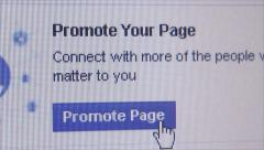 Social Media Macro Close Up: Facebook 'Promote Page' Stock Footage