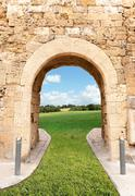 Archway leading to the fields Stock Photos