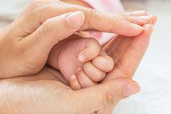New born baby hand - stock photo
