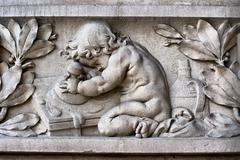 Bas-relief with child Stock Photos