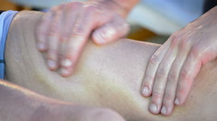 Physiotherapist hands massaging leg of an athlete Stock Footage