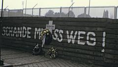 West Berlin 1974: flowers on the wall to remember a dead man escape - stock footage