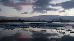 Time lapse sunset at the Jökulsárlón Glacier lagoon in southeast Iceland Stock Footage