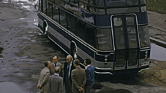 West Berlin 1974: people waiting outside a sightseeing tour bus Stock Footage