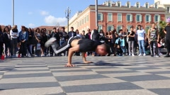Street dancer performing a break-dance routine on Place Massena Stock Footage
