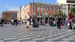 Street dancers performing a break-dance routine on Place Massena in Nice Stock Footage