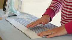 A woman pinning a sewing project Stock Footage