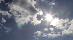 Heavenly Clouds Reveal Beautiful Sun Light Lens Flare in Blue Sky - stock footage
